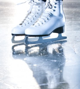 Dramatic blue portrait shot of ice skates